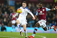 Jamie Vardy of Leicester city (l) goes past IJores Okore of Aston Villa. Barclays Premier league match, Aston Villa v Leicester city at Villa Park in Birmingham, The Midlands on Saturday 16th January 2016.<br /> pic by Andrew Orchard, Andrew Orchard sports photography.