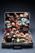 travel trunk stufed with various dolls