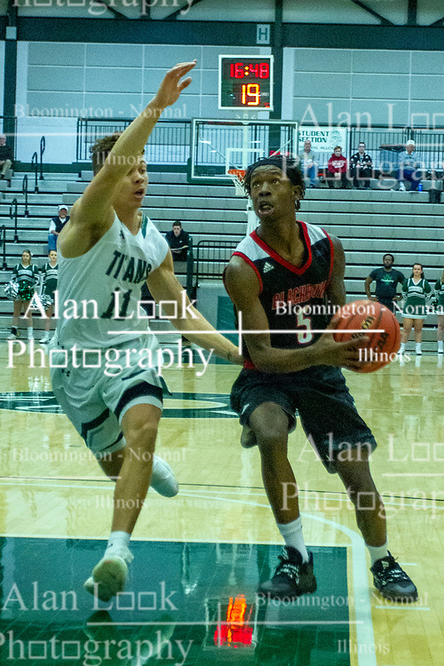 BLOOMINGTON, IL - November 12: 11. Keondre Schumacher defends Chanz Aldridge during a college basketball game between the IWU Titans  and the Blackburn Beavers on November 12 2019 at Shirk Center in Bloomington, IL. (Photo by Alan Look)