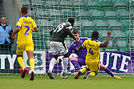 Joe McDonnell (24) of AFC Wimbledon makes a save at the feet of Freddie Ladapo (19) of Plymouth Argyle during the EFL Sky Bet League 1 match between Plymouth Argyle and AFC Wimbledon at Home Park, Plymouth, England on 6 October 2018.