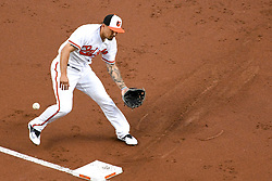 May 12, 2018 - Baltimore, MD, U.S. - BALTIMORE, MD - MAY 12: Baltimore Orioles third baseman Jace Peterson (29) makes an error trying to field a ground ball during the second game of a doubleheader between the Tampa Bay Rays and the Baltimore Orioles on May 12, 2018, at Orioles Park at Camden Yards in Baltimore, MD.  (Photo by Mark Goldman/Icon Sportswire) (Credit Image: © Mark Goldman/Icon SMI via ZUMA Press)