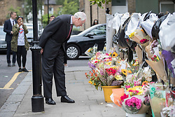 © Licensed to London News Pictures. 29/06/2017. London, UK. Retired Court of Appeal judge Sir Martin Moore-Bick looks at floral tributes at St Clements Church after meeting with Grenfell fire survivors. He has been chosen to lead the public inquiry into the Grenfell Tower fire. Photo credit: Peter Macdiarmid/LNP