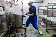 Simon Brennam boiling eels at Barneys Seafood on the last day at the historic Barneys Seafood in Aldgate before a move to Billingsgate Market. The famous wholesale jellied eel and shellfish business started in 1969 supplying Pie and Mash shops and shellfish stalls in East London. Jellied eels are a traditional London dish. London, United Kingdom.