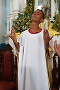 Trainee Priest showing his devotion. Often the lines between Candomble and Catholicism are blurred. This is especially true with the Sao Lazaro event in late January in Salvador, Bahia, Brazil, the city which is known as the home of Candomble. Sao Lazaro represents healing and the sick.