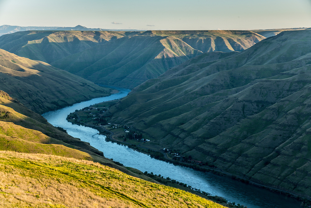 High plateau ranch land and last light on a springtime evening on the lower Snake River in Hells Canyon. Licensing and Open Edition Prints.