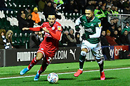 Josh Dacres-Cogley (25) of Crawley Town battles for possession with Byron Moore (17) of Plymouth Argyle during the EFL Sky Bet League 2 match between Plymouth Argyle and Crawley Town at Home Park, Plymouth, England on 28 January 2020.