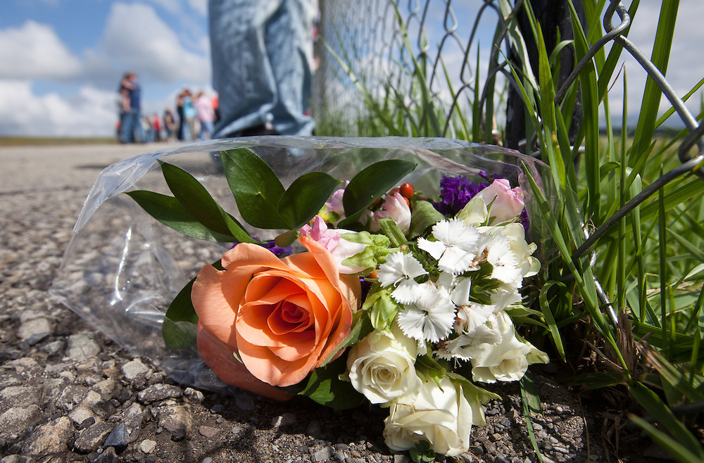 Flowers left at the foot of a fence at  Flight 93 National Memorial site's temporary memorial  overlooking the field where the flight crashed in Shanksville Pennsylvania. The temporary site will close on Sept. 9th at 4 P.M. and on Sept. 10 the official memorial will open in time for the 10th anniversary of 9/11