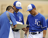SURPRISE, AZ - MARCH 06:  Norichika Aoki #23 of the Kansas City Royals looks over paperwork with coaches prior to the game against the Chicago White Sox on March 6, 2014 at The Ballpark in Surprise in Surprise, Arizona. (Photo by Ron Vesely)   Subject: Norichika Aoki