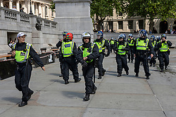 © Licensed to London News Pictures. 13/06/2020. London, UK. Additional police officers arrive as Black Lives Matter and right-wing protesters clash in Trafalgar Square. Protests have taken place across the United States and in cities around the world in response to the killing of George Floyd by police officers in Minneapolis on 25 May. Photo credit: Rob Pinney/LNP