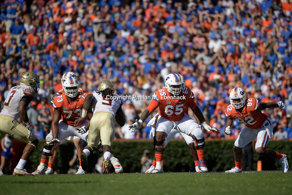 Florida offensive lineman Martez Ivey (73) and offensive lineman Jawaan Taylor (65) set up to block during the first half of an NCAA college football game against Florida State Saturday, Nov. 25, 2017, in Gainesville, Fla. (Photo by Phelan M. Ebenhack)