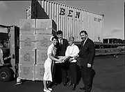 Nurse With Daffodils (Irish Cancer Society)  (R96)..1989..20.02.1989..02.20.1989..20th February 1989..At Container Agencies,Airways Industrial Estate, Dublin a consignment of daffodils arrived for The Irish Cancer Society. The daffodils will be sold to raise funds for the society in their battle against the disease which affects one in three of the Irish population...Image shows a nurse from the cancer society displaying some of the daffodils which will be sold over the coming days to staff at Container Agencies.