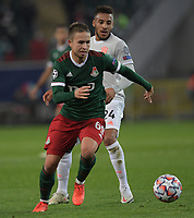 MOSCOW, RUSSIA - OCTOBER 27: Daniil Kulikov of Lokomotiv Moskva [front] and Corentin Tolisso of FC Bayern Muenchen during the UEFA Champions League Group A stage match between Lokomotiv Moskva and FC Bayern Muenchen at RZD Arena on October 27, 2020 in Moscow, Russia. (Photo by MB Media)