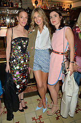 Left to right, TIPHAINE DE LUSSY, KIM HERSOV and LARA BOHINC at a dinner hosted by Kate Spade NY to celebrate Chelsea in Bloom held at Daphne's, 112 Draycott Avenue, London on 20th May 2015.