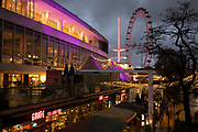 South Bank sunset looking towards the London Eye and Royal Festival Hall on 27th November 2019 in London, England, United Kingdom. The South Bank is a significant arts and entertainment district, and home to an endless list of activities for Londoners, visitors and tourists alike.