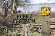 Arrow direction pointer on wooden public footpath sign, Sutton, Suffolk, England