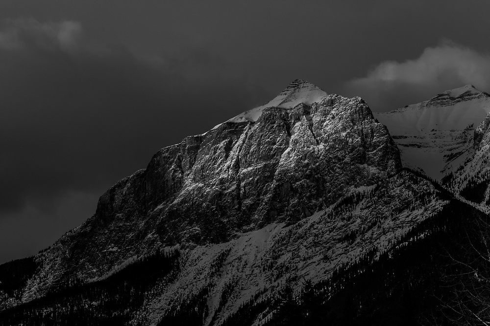 The East End of Mt Rundle high above Canmore at sunrise