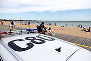 Locals ride by as a police car parks on the beach during COVID-19 in Melbourne, Australia. Premier Daniel Andrews comes down hard on Victorians breaching COVID 19 restrictions, threatening to close beaches if locals continue to flout the rules. This comes as Victoria sees single digit new cases. (Photo by Dave Hewison/Speed Media)