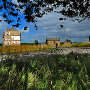 Poverty and young people in Easterhouse, Glasgow. Derelict streets and tenements occupied and unoccupied. Youths on a walk through the streets. A young boy on his bike.Picture Robert Perry The Scotsman 27th July 2012