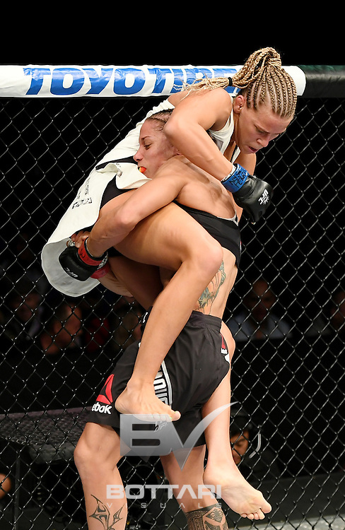 NEW YORK, NY - NOVEMBER 12:  Liz Carmouche of the United States (right) fights against Katlyn Chookagian of the United States in their women's bantamweight bout during the UFC 205 event at Madison Square Garden on November 12, 2016 in New York City.  (Photo by Jeff Bottari/Zuffa LLC/Zuffa LLC via Getty Images)