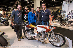 Crew from Santa Lucia del Mela, Italy and North Coast Customs with Francesco Bella's stylish bare metal and wood entry that also sports a North Coast Custom one-of-a-kind 521cc single cylinder engine that they made themselves, at the Intermot Motorcycle Trade Fair. Cologne, Germany. Wednesday October 5, 2016. Photography ©2016 Michael Lichter.