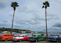 Havana, Cuba - Classic 1950s American cars on Avenida del Puerto near Havana harbor. American cars from the 1950s, imported before the U.S. embargo, are commonly used as taxis in Havana.