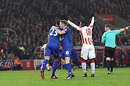 Leonardo Ulloa of Leicester City (l) celebrates with teammate Andy King after scoring his teams 1st goal. Premier league match, Stoke City v Leicester City at the Bet365 Stadium in Stoke on Trent, Staffs on Saturday 17th December 2016.<br /> pic by Chris Stading, Andrew Orchard sports photography.