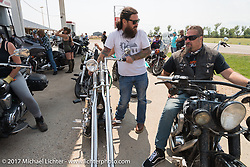 Noah O'Geen and Randy Noldge at a gas stop on highway 79 on the Run to the Line for lunch and biker vs Cowboy rodeo games at the Spur Creek Ranch in Newell during the annual Sturgis Black Hills Motorcycle Rally. SD, USA. Wednesday August 9, 2017. Photography ©2017 Michael Lichter.