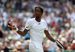Gael Monfils celebrates victory over Kyle Edmund on day four of the Wimbledon Championships at The All England Lawn Tennis and Croquet Club, Wimbledon.