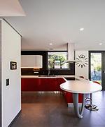 Red kitchen detail in modern villa. Nobody inside