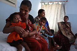 Sisters Manjula Pandya, 30, Pushpa Pandya, 27, and Gauri Pandya, 29, gather with their children respectively Raj Pandya, 1, and Karan Pandya, 6, at Anand's Kaival Hospital in Anand, India on April 14, 2007. Pushpa was the first successful surrogate at the clinic. Manjual and Gauri are Pushpa's sisters-in-law, and became involved after seeing her success. Dr. Nayna Patel, director of Anand's Kaival Hospital, currently has more than 25 women who have been implanted with embryos at her clinic. A few have already gone through the process once and are eager for a second go-round. While Patel claims many of the women do this for altruistic reasons, she acknowledges that money was the primary reason these women had queued up to be surrogates; without it, the list would be short, if not nonexistent. Payment usually ranges from about $2,800 to $5,600, a fortune in a country where annual per capita income hovers around $500.