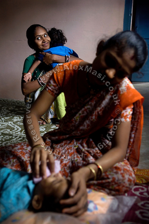 Children are taking part to a physiotherapy session with their mothers at Chingari Trust, in Bhopal, Madhya Pradesh. The trust offers assistance, education, physiotherapy and advice to hundreds of children born from gas-affected parents or being fed highly contaminated water since a very early age, when the body is more likely to be affected and to suffer irreparable damage.