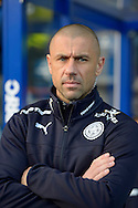 Leicester City First Team Coach Kevin Phillips in the away dugout before k/o. Barclays Premier league match, Queens Park Rangers v Leicester city at Loftus Road in London on Saturday 29th November 2014.<br /> pic by John Patrick Fletcher, Andrew Orchard sports photography.