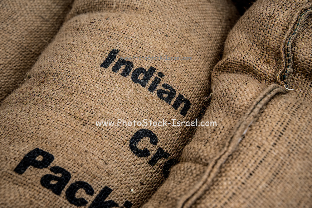 Sacks of coffee beans at a coffee importer's warehouse