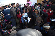 March 1, 2016 - Athens, Greece - <br /> <br /> Refugges and migrants wait to be allowed to cross the border to Macedonia in the northern Greek border station of Idomeni. Greek police said up to 10,000 mostly Syrian and Iraqi refugees were stuck at the country's Idomeni border crossing in deteriorating conditions. <br /> ©Exclusivepix Media
