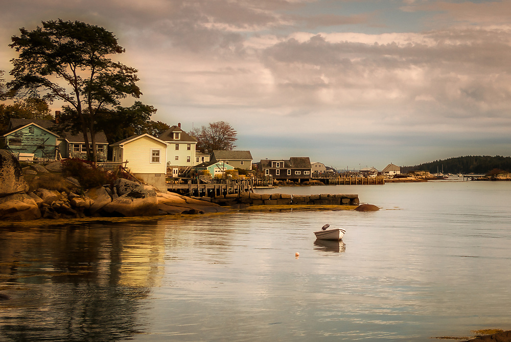 Tranquil afternoon as the rising tide fills the waterfront at Stonington.