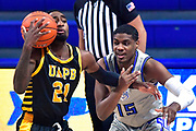 Arkansas-Pine Bluff Golden Lions guard Shaun Doss Jr. (21, left) and St Louis Billikens guard Demarius Jacobs (15) bump into each other. St. Louis University hosted the University of Arkansas - Pine Bluff in a mens basketball game on December 5, 2020 at Chaifetz Arena on the SLU campus in St. Louis, MO.<br /> Photo by Tim Vizer