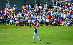 Justin Thomas runs to the 17th green to check if Patrick Reed's ball had landed along the edge of the green during first round action of the PGA Championship at Quail Hollow Club Thursday, Aug. 10, 2017 in Charlotte, N.C. (Photo by Jeff Siner/Charlotte Observer/TNS/Sipa USA)  *** Please Use Credit from Credit Field ***