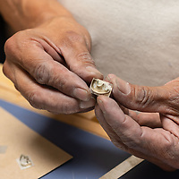 Carlton Jamon, 56, shows the beginning stages to one of his favorite types of silver jewelry, during the Zuni Art Walk and Market on Saturday in Zuni Pueblo.