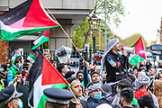 "London, United Kingdom - May 9, 2021: People are participating in ""Protest for Jerusalem"" outside the Israeli Embassy in London on Sunday, May 9, 2021. This is a series of protests which will be held also in Manchester, Birmingham and Bradford against the planned evictions of Palestinian families in the Sheikh Jarrah neighbourhood of East Jerusalem this week. Protestors dispersed peacefully chanting ""Free, Free Palestine!"". (Photo/ Vudi Xhymshiti)"