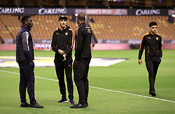 """Wolverhampton Wanderers players inspect the pitch before the Sky Bet Championship match at Molineux, Wolverhampton. PRESS ASSOCIATION Photo. Picture date: Tuesday March 13, 2018. See PA story SOCCER Wolves. Photo credit should read: Nigel French/PA Wire. RESTRICTIONS: EDITORIAL USE ONLY No use with unauthorised audio, video, data, fixture lists, club/league logos or """"live"""" services. Online in-match use limited to 75 images, no video emulation. No use in betting, games or single club/league/player publications."""