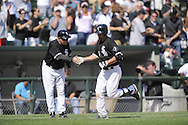 CHICAGO - AUGUST 14:  Paul Konerko #14 of the Chicago White Sox is congratulated by third base coach Jeff Cox #6 after hitting the second of four consecutive White Sox home runs, tying a Major League record, during the game against the Kansas City Royals at U.S. Cellular Field in Chicago, Illinois on August 14, 2008.  The White Sox defeated the Royals 9-2.  (Photo by Ron Vesely)