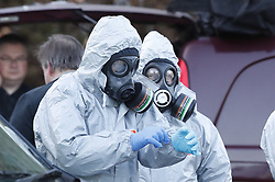 © Licensed to London News Pictures. 07/03/2018. Salisbury, UK. Police seen putting on protective suits and gas masks in preparation to carry out further investigation work in Salisbury. Former Russian spy Sergei Skripal and his daughter were taken il following a suspected poisoning in the city. The couple where found unconscious on bench in Salisbury shopping centre. Specialist units have been called in to deal with any possible contamination. Photo credit: Peter Macdiarmid/LNP