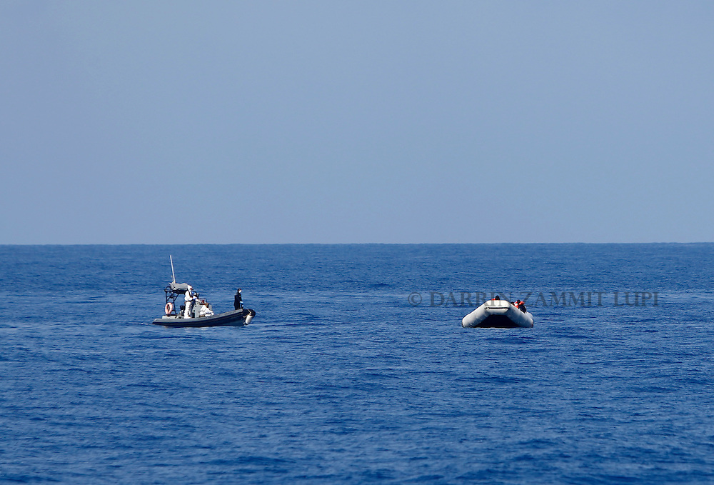 An Italian Navy RHIB (rigid hulled inflatable boat) from the ship Francesco Mimbelli approaches a rubber dinghy carrying migrants during a rescue operation off the coast of Libya August 6, 2015.  More than 200 migrants are feared to have drowned in the latest Mediterranean boat tragedy after rescuers saved over 370 people from a capsized boat thought to be carrying 600, the Italian coast guard indicated on Thursday.<br /> REUTERS/Darrin Zammit Lupi <br /> MALTA OUT. NO COMMERCIAL OR EDITORIAL SALES IN MALTA