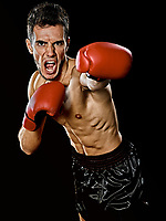 one caucasian young player man boxer boxing portrait waist up in studio isolated on black background
