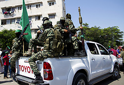 July 21, 2017 - Gaza City, The Gaza Strip, Palestine - Masked gunmen from the Izz el-Deen al-Qassam Brigades, the military wing of Hamas, installed cars during a protest against new Israeli security measures at the entrance to Al-Aqsa Mosque on July 21, 2017. (Credit Image: © Mahmoud Issa/Quds Net News via ZUMA Wire)