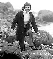 A duffle-coated Rev Ruth Patterson, Larne, Co Antrim, N Ireland, the first woman to be ordained into the ministry of the Presbyterian Church in Ireland. January 1976, has a stroll along the Co Antrim shore. 197601030002b<br /> <br /> Copyright Image from Victor Patterson, 54 Dorchester Park, Belfast, UK, BT9 6RJ<br /> <br /> Tel: +44 28 9066 1296<br /> Mob: +44 7802 353836<br /> Voicemail +44 20 8816 7153<br /> Skype: victorpattersonbelfast<br /> Email: victorpatterson@me.com<br /> Email: victor@victorpatterson.com<br /> <br /> IMPORTANT: If you wish to use this image or any other of my images please go to www.victorpatterson.com and click on the Terms & Conditions. Then contact me by email or phone with the reference number(s) of the image(s) concerned.