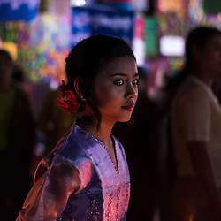 A Shan girl in her traditional dress roams the festival grounds.