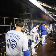 Jose Bautista, (left) and Jose Reyes, (center), Toronto Blue Jays, in the dugout preparing to bat during the New York Mets Vs Toronto Blue Jays MLB regular season baseball game at Citi Field, Queens, New York. USA. 16th June 2015. Photo Tim Clayton