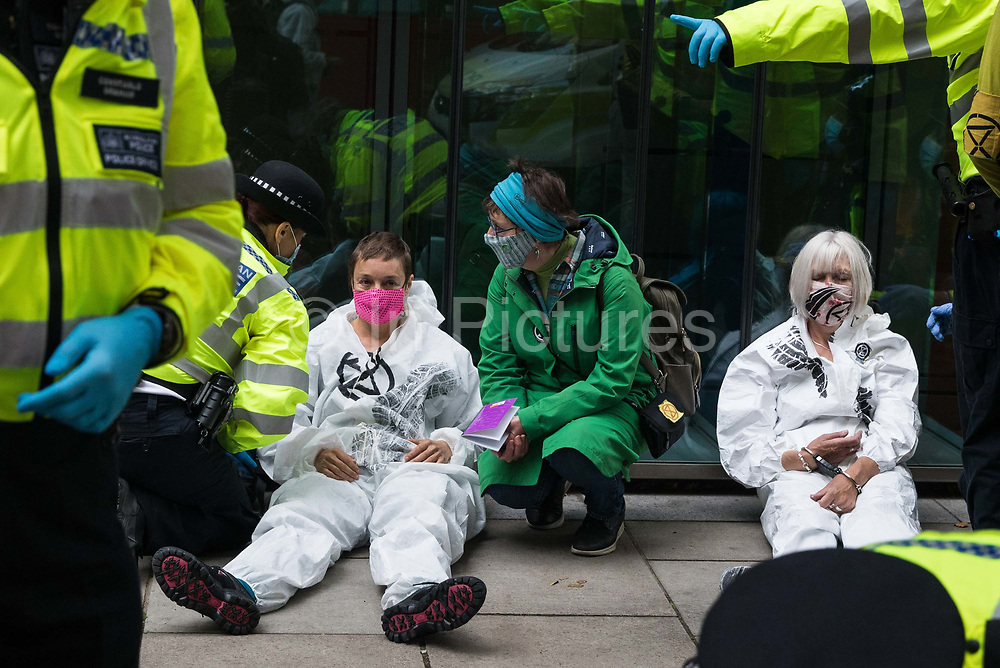 Metropolitan Police officers arrest climate activists from Extinction Rebellion who had occupied the street outside the Department of Transport in protest against roadbuilding on 3 September 2020 in London, United Kingdom. Extinction Rebellion activists are attending a series of September Rebellion protests around the UK to call on politicians to back the Climate and Ecological Emergency Bill CEE Bill which requires, among other measures, a serious plan to deal with the UK's share of emissions and to halt critical rises in global temperatures and for ordinary people to be involved in future environmental planning by means of a Citizens' Assembly.