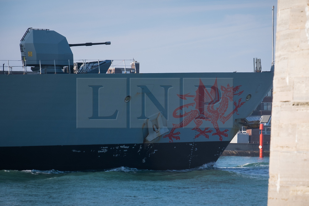 © Licensed to London News Pictures. 02/11/2017. Portsmouth, UK.  The Welsh dragon on the bow of HMS Dragon as she sails into her home port of Portsmouth for the first time in two months.  The Type 45 destroyer has been on a deployment involving exercises with the U.S. Navy and also a visit to the British Overseas Territory of Gibraltar.  Photo credit: Rob Arnold/LNP